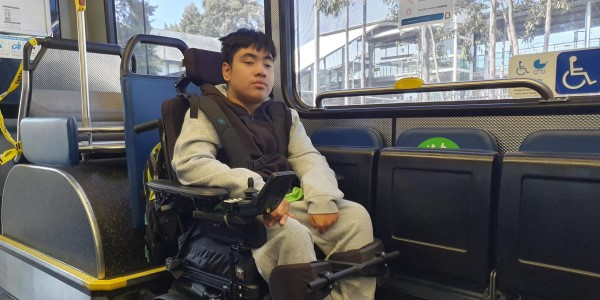 boy in wheelchair on bus